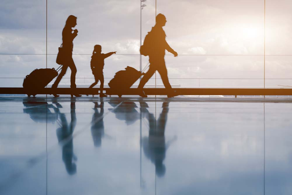 immigrants walking through airport
