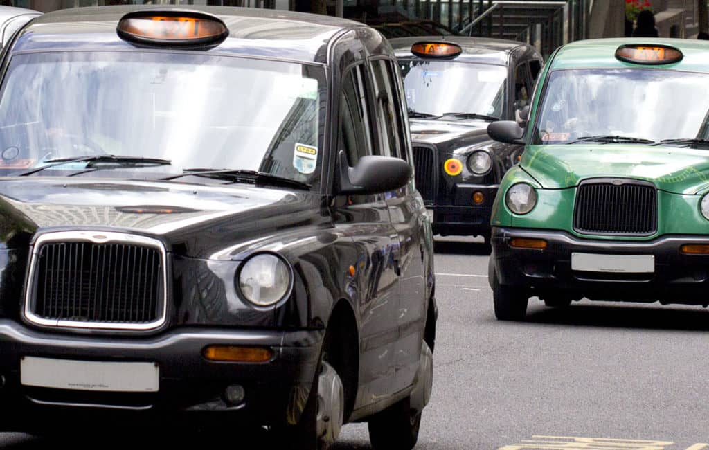 Taxis driving around town